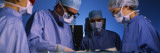 Four Surgeons in an Operating Room  Hospital