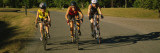 Three Adult Women Cycling