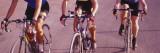 Three Women Cycling