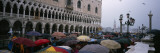 Tourists with Umbrellas on a Town Square  St Mark&#39;s Square  Venice  Veneto  Italy