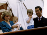 Prince Charles stands holding sons Prince William and Prince Harry with Princess Diana  Circa 1985