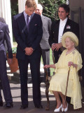 Prince William bends down to talk to The Queen Mother outside Clarence House where she was celebrat