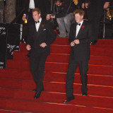 Prince William (left) and his brother Prince Harry arrive for the world premiere of the new James B