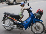 Young Motorcyclist with Goggles on Stationary Motorcycle