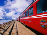 Pikes Peak Cog Railway Train with Visitors Looking Out from Pikes Peak