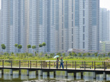 People on Walking Trail Through the Hong Kong Wetland Park  Tin Shui Wai  New Territories