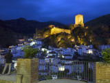 Tourist Taking Picture from Pintor Zabaleta Balcony of La Yedra Castle Illuminated at Night