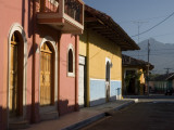 Colourful Houses on Street with Volcán Mombacho in Background