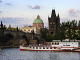 Vltava River with Charles Bridge and Cruise Boat