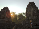 Female Tourist Photographer at Bayon Temple at Sunset
