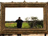 Man Taking Photo Inside Giant Frame Overlooking Werribee Open Range Zoo