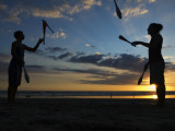 Silhouetted Jugglers on the Beach