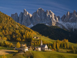 San Maddalena Church in Val Di Funes  with Peaks of Parco Naturale Puez-Odle in Background