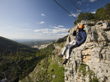 Man Suspended on Flying Fox Watching over Village of Cazorla
