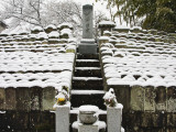 Graveyard with Headstones Covered with Snow