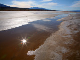 Temporary Waterway in Floor of Death Valley in Winter  with Reflection of Sun in Water
