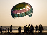 Paragliders on Beach at Sunset