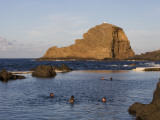 People in Natural Swimming Rock Pools and Ilheu Mole Island