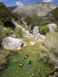 Group of Friends Practising Canyoning in Guadalquivir River