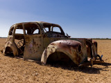 Old Abandoned Car in Fallow Field