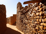 Narrow Alleyway Through Ruins of Desert Town