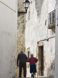 Rear View of Old Couple Walking in Street