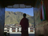 Monk Silhouetted in Doorway  Tashilhunpo Monastery
