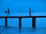 Two Boys Walking on Occidental Grand Cozumel Resort Pier at Sunset