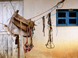 Home-Made Saddle Hanging Outside on Ropes