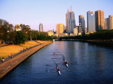 Rowers on Yarra River with City Skyscrapers in Background