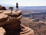 Woman on Ledge Looking at Green River Canyon Landscape from Grand View Point Overlook