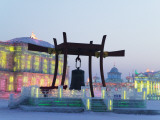 Bronze Bell and Illuminated Ice Sculptures of Traditional Architecture at Ice Festival