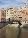 Woman Crossing Pont D'En Gomez Above Onyar River before Colourful Old Buildings
