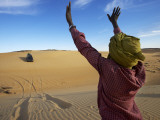 Tuareg Man Guiding 4Wd Car Through Soft Sand Dune