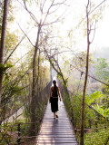 Woman Crossing Bridge Between Lobby and Accomodation Area at Four Seasons Tented Camp