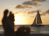 Relaxing Feet and Catamaran at Sunset Seen from Bucuti Beach Resort on Eagle Beach