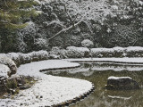 Snow Covered Trees Near Pond in Garden of Heian Shrine
