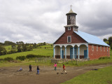 Children Playing Soccer in Front of Iglesia De Putchitco Church
