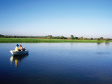 Anglers in Boat Fishing for Barramundi in Yellow Water Wetlands