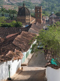 Cobblestone Street with Colonial Houses and Catedral De La Inmaculada Concepcion in Background