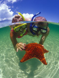 Two People Snorkelling with Starfish