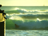 Green Afternoon Waves Off the Wall at Waikiki with a Boogie Boarder on the Side at the Wall