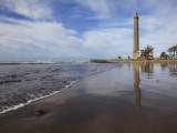 Maspalomas Beach with Maspalomas Lighthouse (Faro De Maspalomas) Reflected in Wet Sand