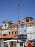 Historical Pole in Frane Petrica Square (Trg Frane Petrica) with City Clock Beyond