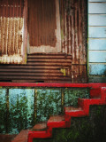 Detail of Red Stairs and Corrugated Tin Wall