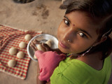 Young Girl Preparing Dough for Roti