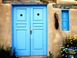 Blue Door on Adobe Building