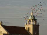 Balloons Flying over Church