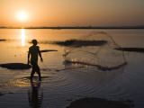 Fisherman Casting Net in the Niger River at Segoukoro