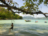 Young Boy on Rope Swing at Tri Trang Beach